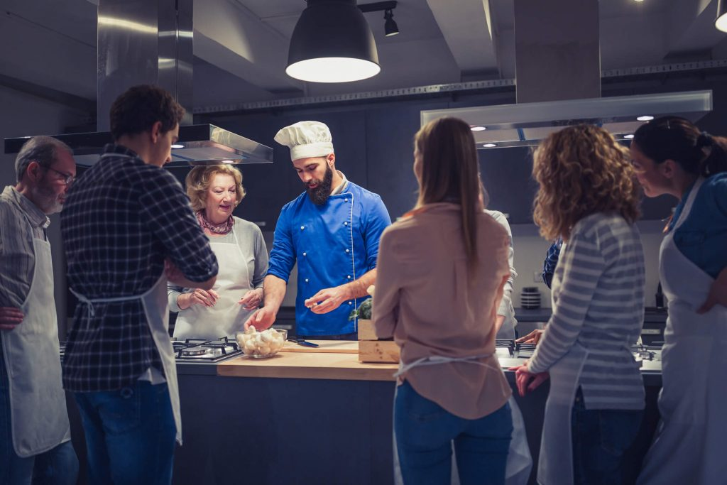 Chef shows students how to prepare Tuscan food