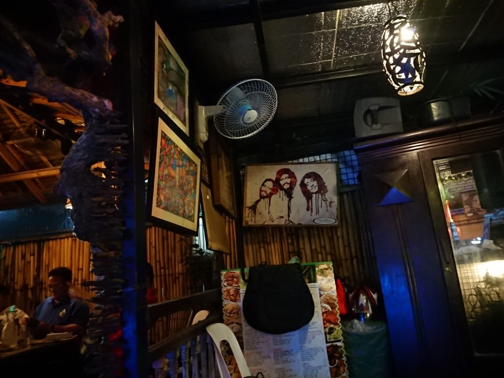 Local artwork hangs on the walls of Bambu Intramuros Art Bar & Restaurant