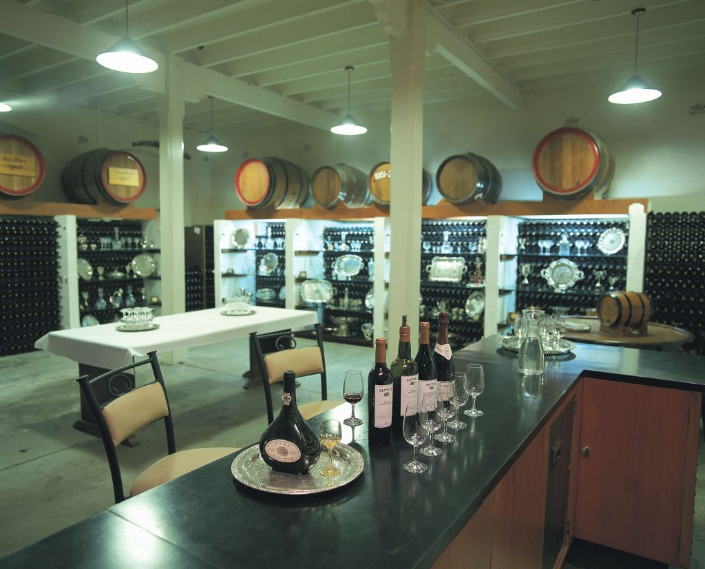 Wine tasting display with bottles and glasses