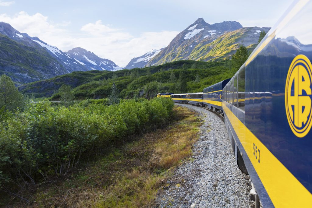 Railcars take visitors on shore excursions in Skagway, Alaska
