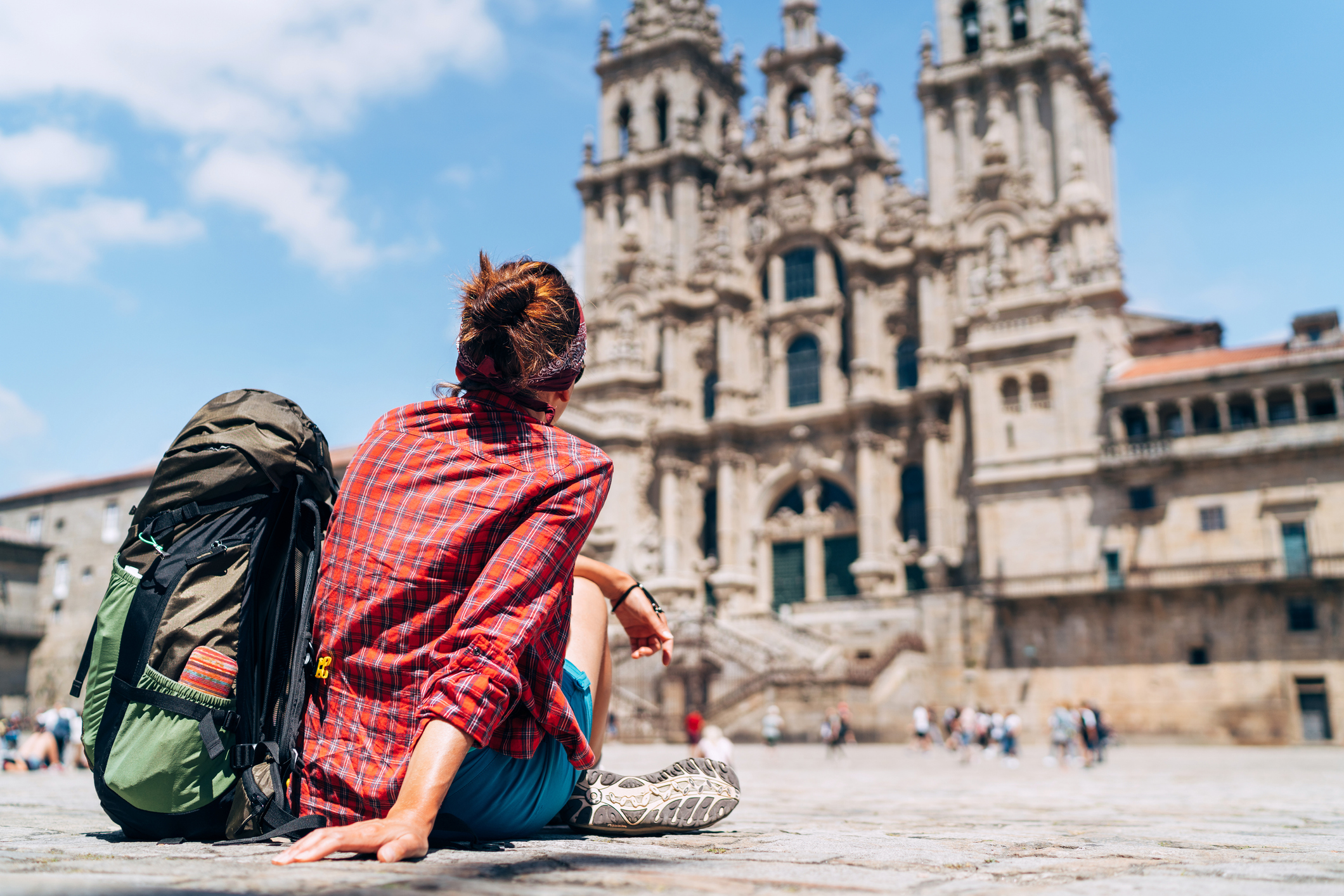 Solo backpacker looking at cathedral