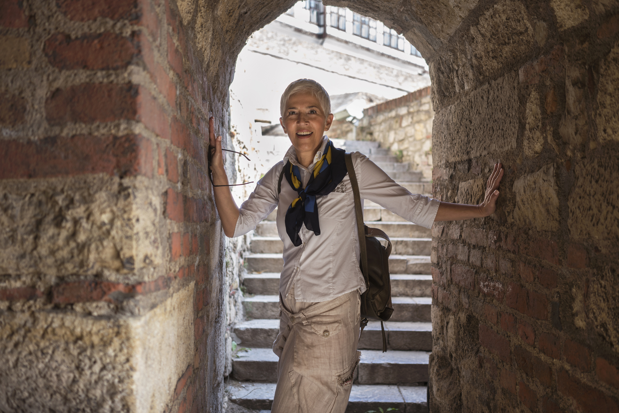 Woman explores old archway