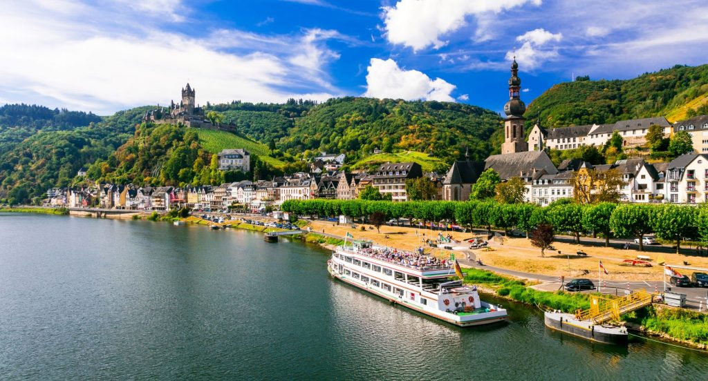 Romantic river cruise through medieval town of Rhein Germany looking over the hillside
