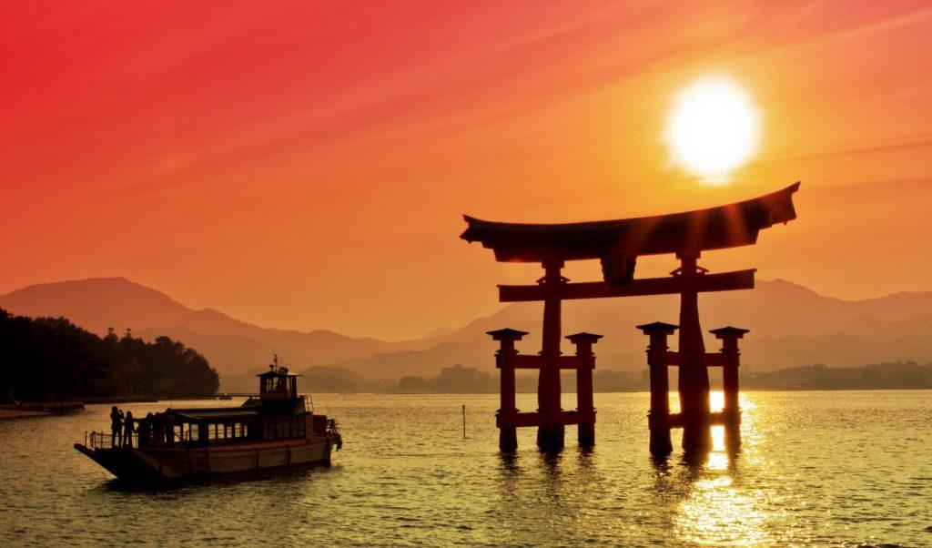 Sunset view of Torii gate, High tide, Miyajima, Japan