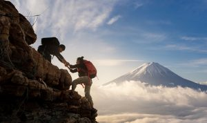 Asians hiking through mountains in Japan with Mount Fuji in the background